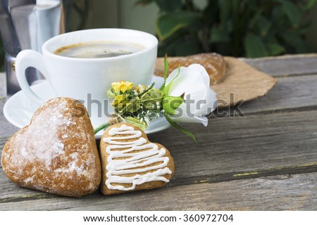 Heart shaped  cookies (big and small as couple), cup of coffee, bouquet of flowers decoration. sunny morning.Steam (geyser) coffee maker. Romantic breakfast or  Valentine's Day Breakfast. Toned image