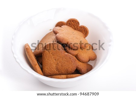 Heart-shaped cookies in white plate on white