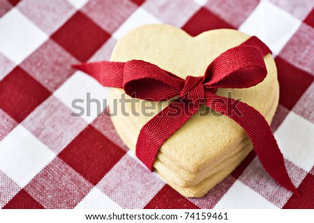 Heart shaped cookies with a red ribbon on cloth