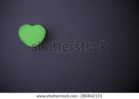 Heart-shaped cube on blackboard #280842131