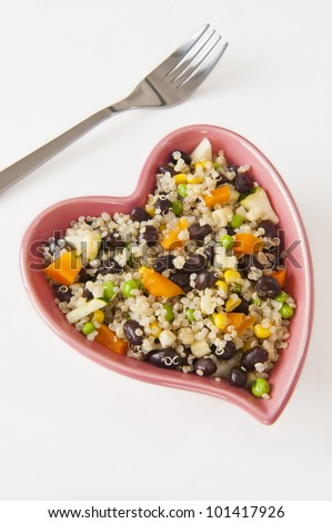 Heart shaped dish filled with quinoa and vegetable salad