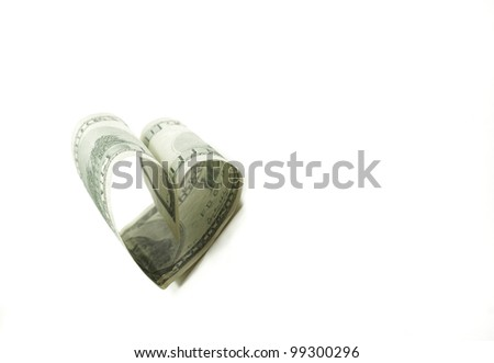 heart shaped 100 dollar bill isolated on white background