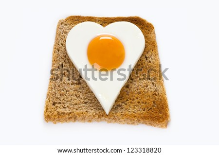 heart shaped egg on a slice of toast