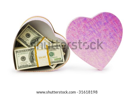 Heart shaped gift box and dollars inside