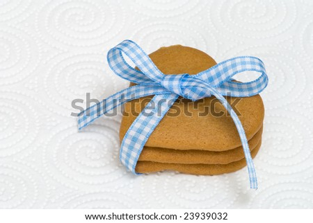 Heart shaped ginger cookies tied with pretty bow