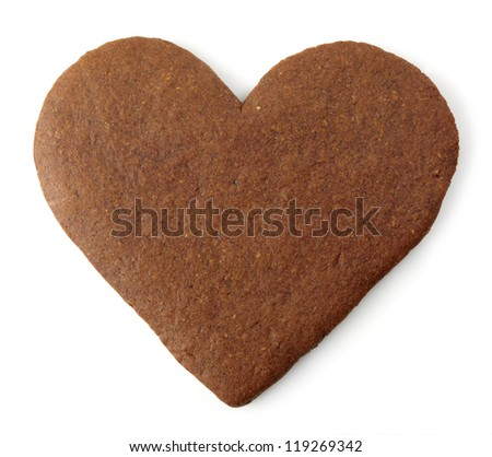 Heart shaped gingerbread cookie on white background