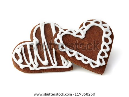Heart shaped gingerbread cookies on white background