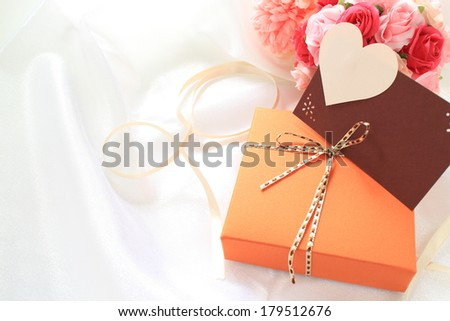 heart shaped greeting card with chocolate gift box for valentine\'s day and holiday image