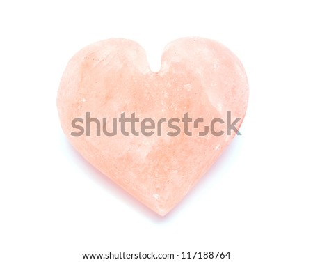 heart-shaped himalayan salt isolated on white background