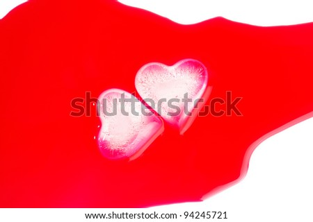 Heart-shaped ice cubes in red juice