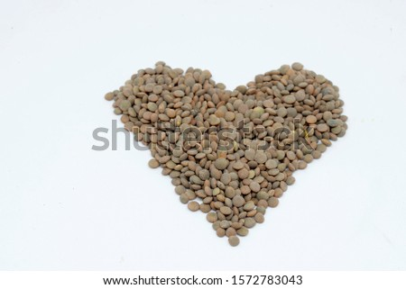 heart-shaped lentils or legumes on white background