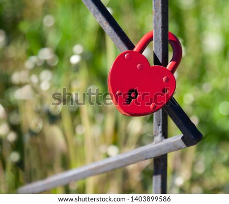 Heart-shaped lock hanging on metal construction, pledge of allegiance  #1403899586