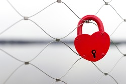Heart shaped love padlock - beautiful wedding day custom. Shallow depth of field