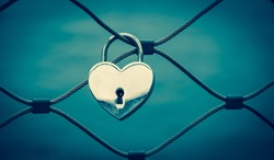 Heart shaped love padlock in Paris. Valentine's day background. Toned photo.