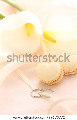 heart shaped macaroon and wedding ring with Calla lily)