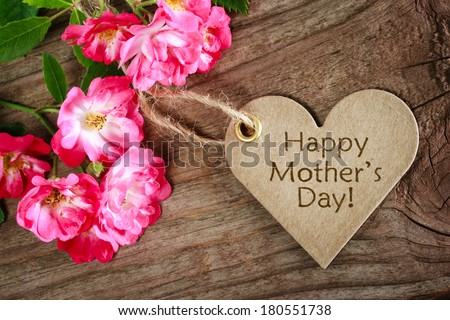 Heart shaped mothers day card with roses on wood background #180551738