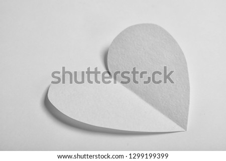Heart shaped paper cutout on white background #1299199399