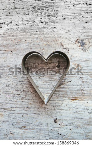 Heart shaped pastry cutter on a wooden background #158869346