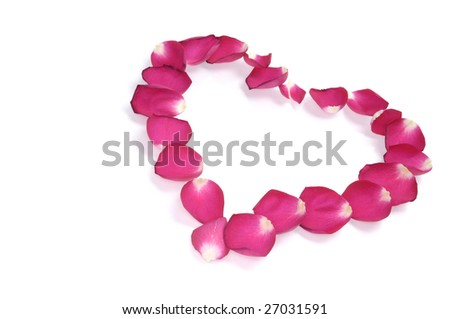 Heart-shaped pattern made from red rose petals isolated on white background