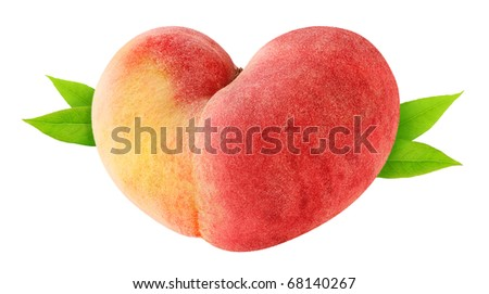 Heart-shaped peach with leaves isolated on white