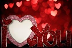 Heart shaped photo frame on defocused bokeh background