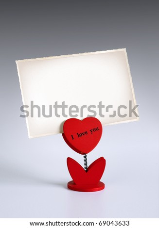 heart-shaped photo holder saying I Love You holding photo