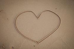Heart shaped photos on the sandy beach