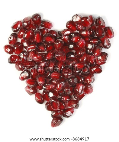 Heart shaped pomegranate seeds, high key, vivid and detailed