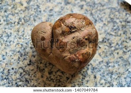 heart shaped potato in the kitchen #1407049784