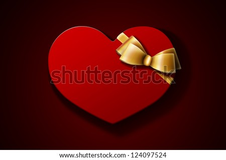 Heart-shaped red gift box with golden bow on dark background. A Valentine\'s Day gift / wedding gift.