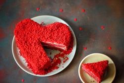 heart shaped red velvet cake on dark background slide aside