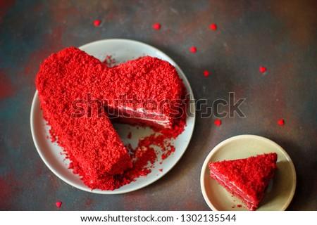 heart shaped red velvet cake on dark background slide aside #1302135544