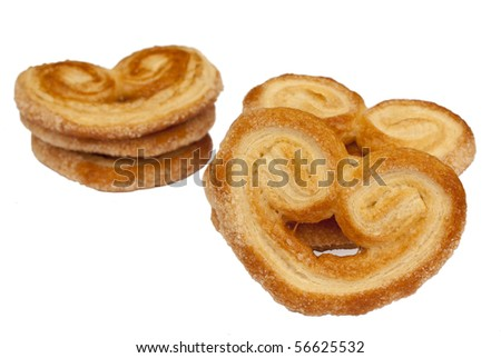 Heart shaped saporelly puff pastry isolated over a white background.