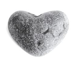 Heart-shaped sea stone (pebble) on white background