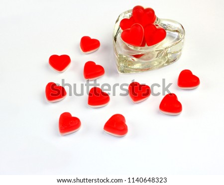 Heart shaped sweets in heart shape with heart shaped glass container #1140648323