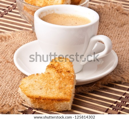 heart-shaped toast  and a cup of coffee