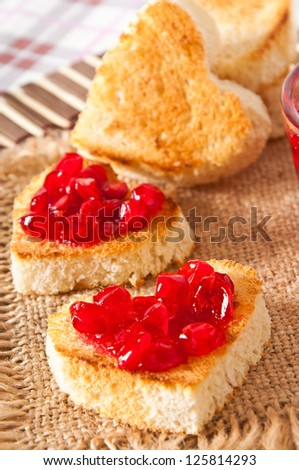 heart-shaped toast with jam