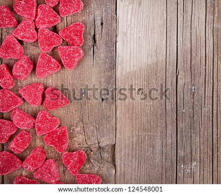 heart shaped valentine candy on wooden plank