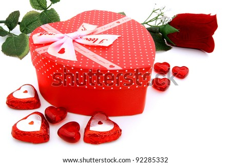 Heart-shaped Valentines Day gift box with rose and gems