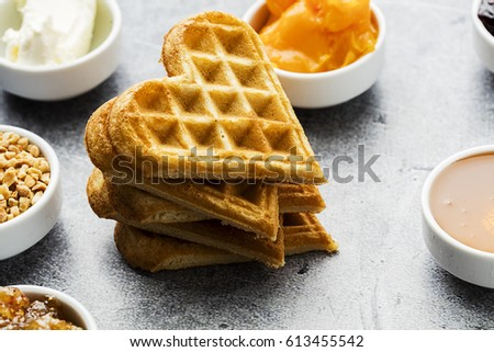 Heart shaped waffles served with different sauce #613455542