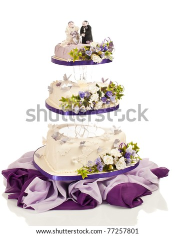 stock photo Heart shaped wedding cake in three tiers with flowers and