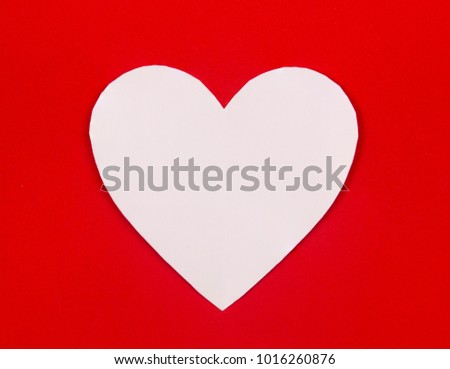 Heart shaped white paper in red background, Heart cut from white paper, Valentines Day background, Holiday Card, Romantic atmosphere