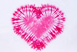 heart sign tie dye pattern on cotton fabric background.