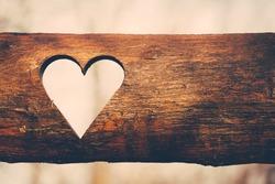 Heart singh on plank. Retro filter, grain added.