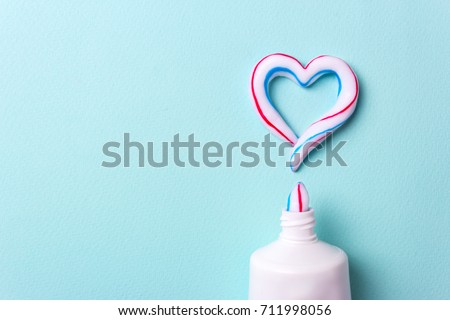 Heart symbol and love from toothpaste. Copy space for text