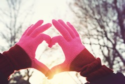 Heart symbol at sunset. Instagram effect