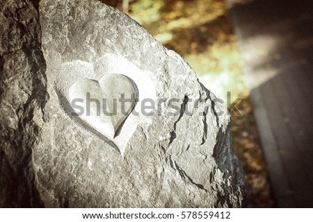Heart symbol etched in stone.  #578559412