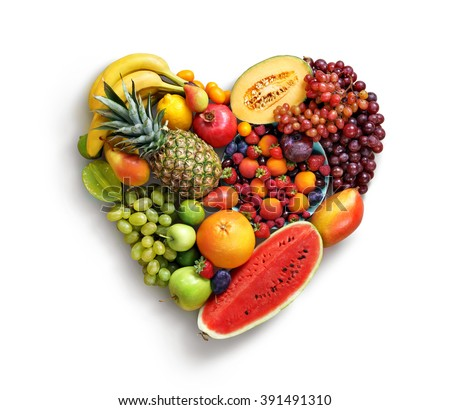 Heart symbol. Fruits diet concept. Food photography of heart made from different fruits isolated white background. High resolution product #391491310