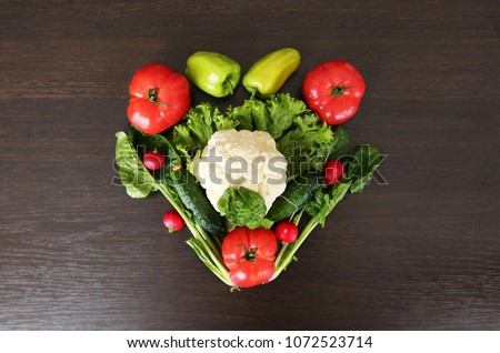 Heart symbol. Healthy eating concept .Vegetables diet concept. Food photography of heart made from different vegetables isolated on wooden table. Heart shape by various vegetables. - Shutterstock ID 1072523714