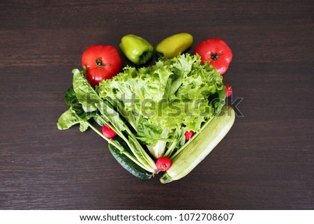 Heart symbol. Healthy eating concept .Vegetables diet concept. Food photography of heart made from different vegetables isolated on wooden table. Heart shape by various vegetables - Shutterstock ID 1072708607
